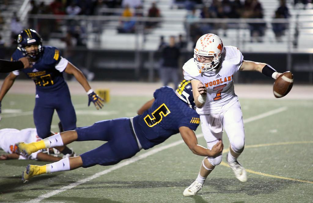 . MATT MURPHY - DAILY DEMOCRAT Woodland High quarterback Christian Stice scrambles and escapes a sack against Inderkum on Oct. 16.