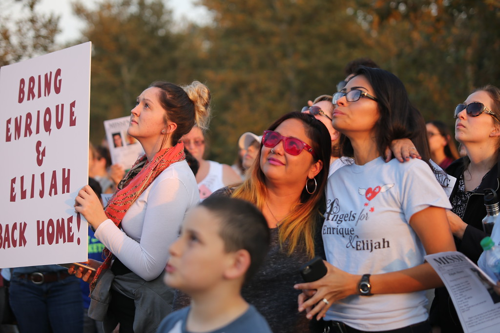 . SARAH DOWLING - DAILY DEMOCRAT Friends and family of Enrique Rios watch as balloons fill the sky above Woodland. The balloons were released in Rios\'s honor. The teen has been missing for more than a year.