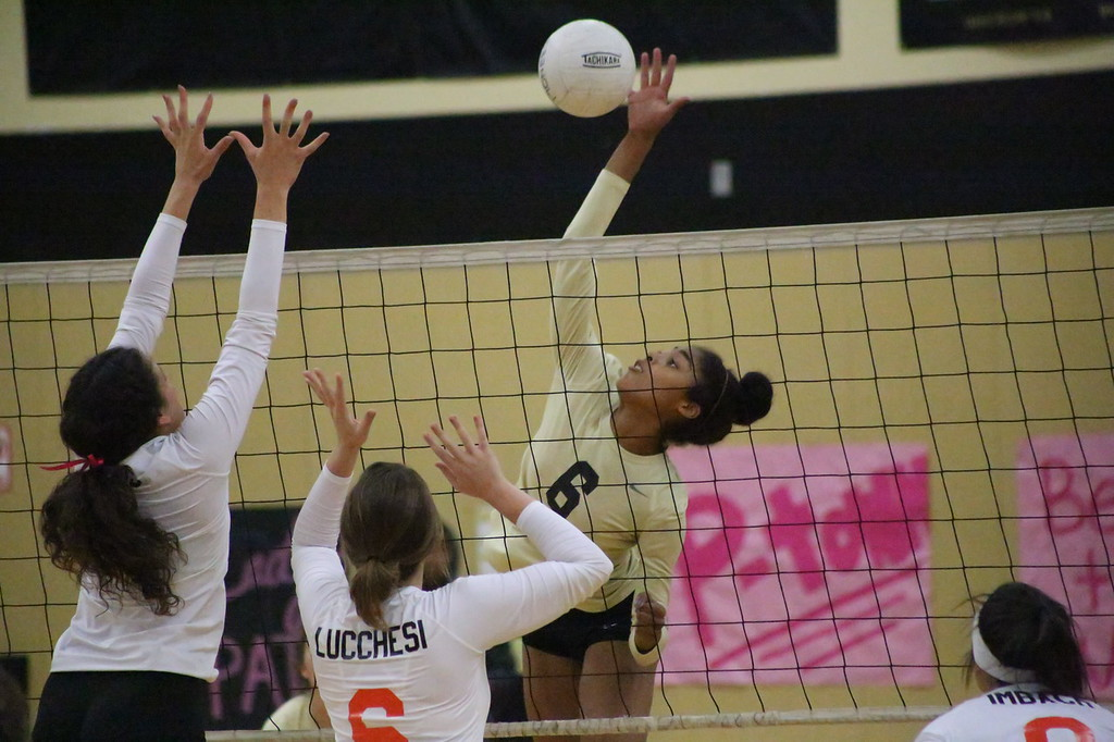 . MATT MURPHY - DAILY DEMOCRAT Pioneer\'s Trinity Barr finds room for a kill between Woodland High\'s Zoe Wais and Sarah Luchessi during a game on Oct. 26.