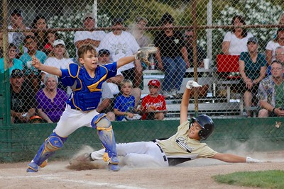 HANS PETER - DAILY DEMOCRAT Woodland and Davis Little League teams battled it out this summer (he was safe).