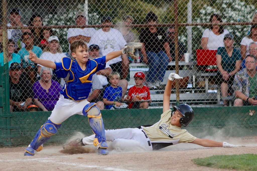 . HANS PETER - DAILY DEMOCRAT Woodland and Davis Little League teams battled it out this summer (he was safe).