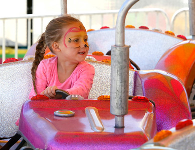 Shaun Walker — The Times-Standard  Mikayla Jackson, 4, of Arcata ejoys a kids truck ride at The Best of Humboldt Fair on Saturday. For more information, go to redwoodacres.com.