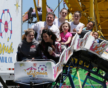 Shaun Walker — The Times-Standard  Young and old enjoy the small roller coaster at the fair on Saturday.