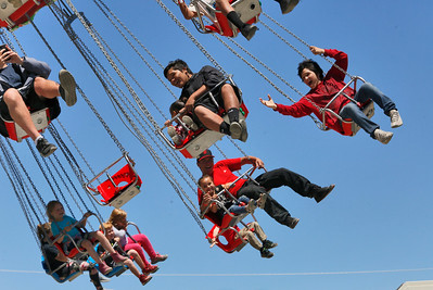 Shaun Walker — The Times-Standard  Riders enjoy flying through the air at the fair on Saturday.
