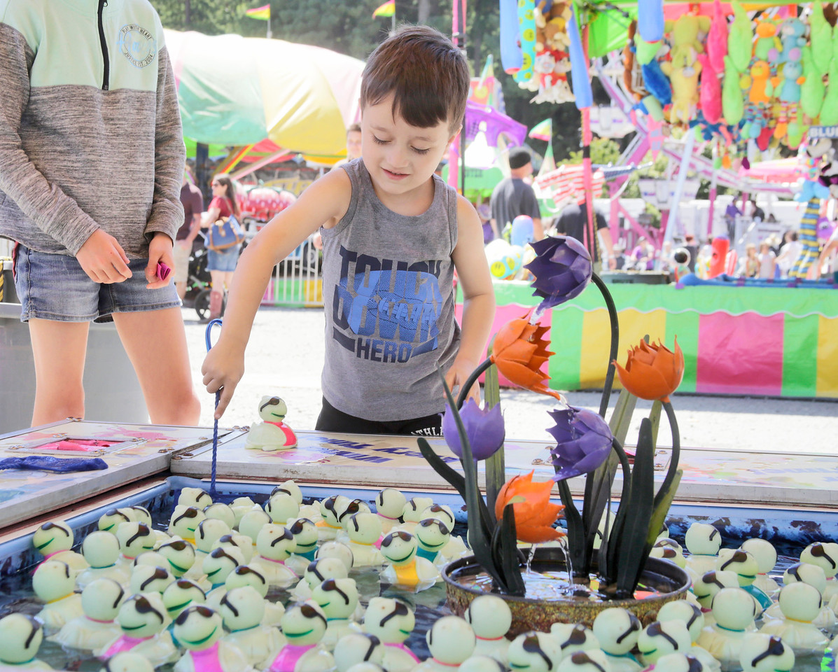 Shaun Walker — The Times-Standard  Godric Douglas, 5, of Rio Dell fishes a rubber ducky out of carnival game at the Best of Humboldt Fair at Redwood Acres in Eureka on Saturday. The fair ends at 5 p.m. today. For more information, go to redwoodacres.com.