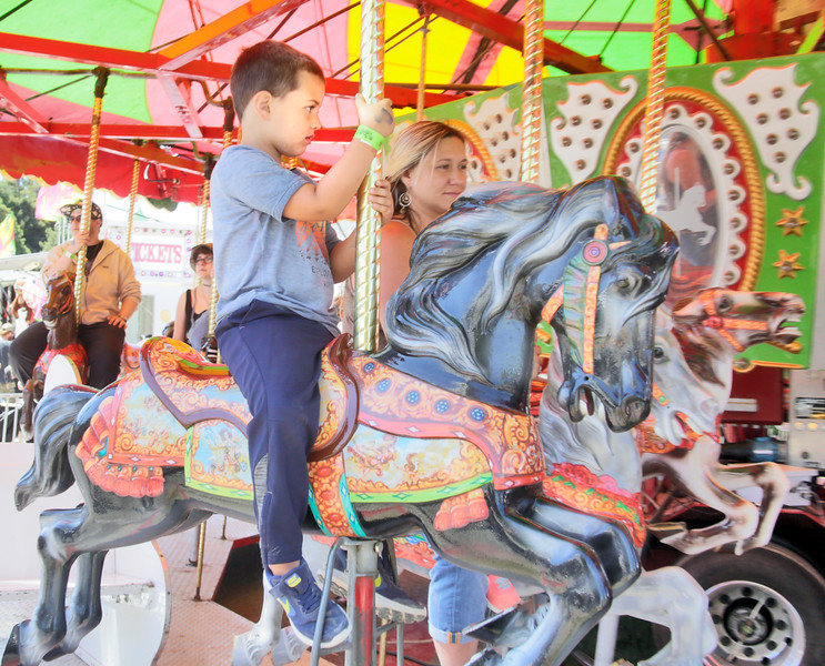 Shaun Walker — The Times-Standard  Nakaia Mendes, 4, of Redway rides the carousel at the Best of Humboldt Fair at Redwood Acres in Eureka on Saturday. The fair ends at 5 p.m. today. For more information, go to redwoodacres.com.