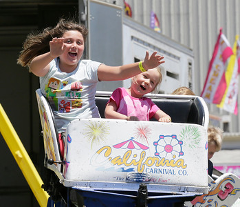 Shaun Walker — The Times-Standard  Jaylyn Mackelburg, 8, and cousin Iris, 4, both of Crescent City, ride a small roller coaster at the Best of Humboldt Fair at Redwood Acres in Eureka on Friday. The fair continues through Sunday at 5 p.m. and features rides, animals, shows, food, exhibits, and games. For more information, go to redwoodacres.com.