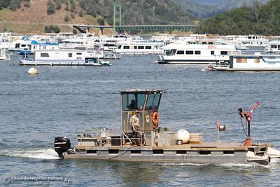 A California State Park vessel crosses through Lake Oroville, the lake is now staffed April 25, 2016 at the Bidwell Bar in Oroville, Calif. (Emily Bertolino -- Enterprise-Record)