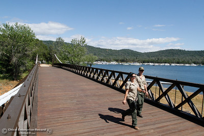 California State Park rangers Shelby Barcus and Chelsea Douglas cross the Bidwell Bar Suspension Bridge April 25, 2016 at the Bidwell Bar in Oroville, Calif. (Emily Bertolino -- Enterprise-Record)