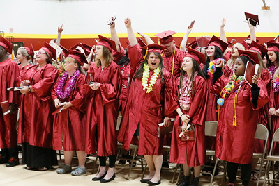 Shaun Walker — The Times-Standard  Some of the 598 College of the Redwoods 2018 celebrate at the end of the community college's ceremony Saturday morning.