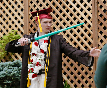 Shaun Walker — The Times-Standard  College of the Redwoods student Joey Lawrence decides to graduate and pose as a Jedi at the ceremony Saturday morning.
