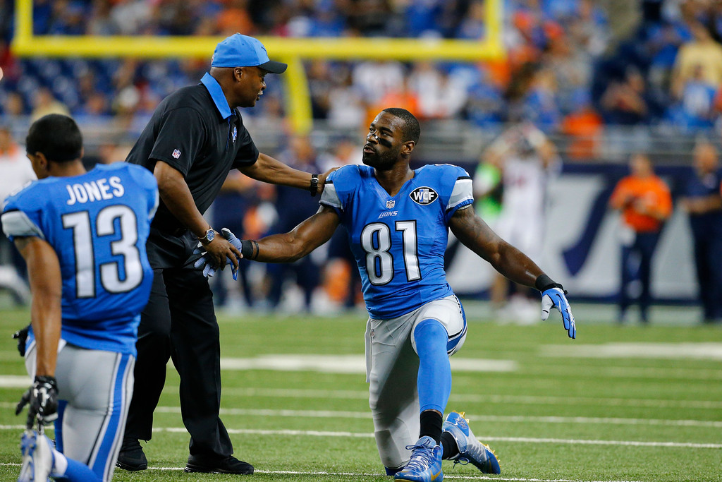 . Detroit Lions wide receiver Calvin Johnson shakes hands with head coach Jim Caldwell during warmups before an NFL football game against the Denver Broncos, Sunday, Sept. 27, 2015, in Detroit. (AP Photo/Rick Osentoski)