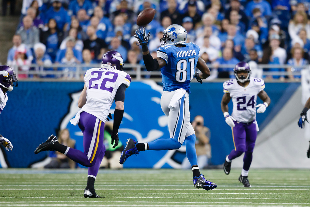 . Detroit Lions wide receiver Calvin Johnson (81) can\'t make a catch defended by Minnesota Vikings free safety Harrison Smith (22) and cornerback Captain Munnerlyn (24) during an NFL football game at Ford Field in Detroit, Sunday, Dec. 14, 2014. (AP Photo/Rick Osentoski)