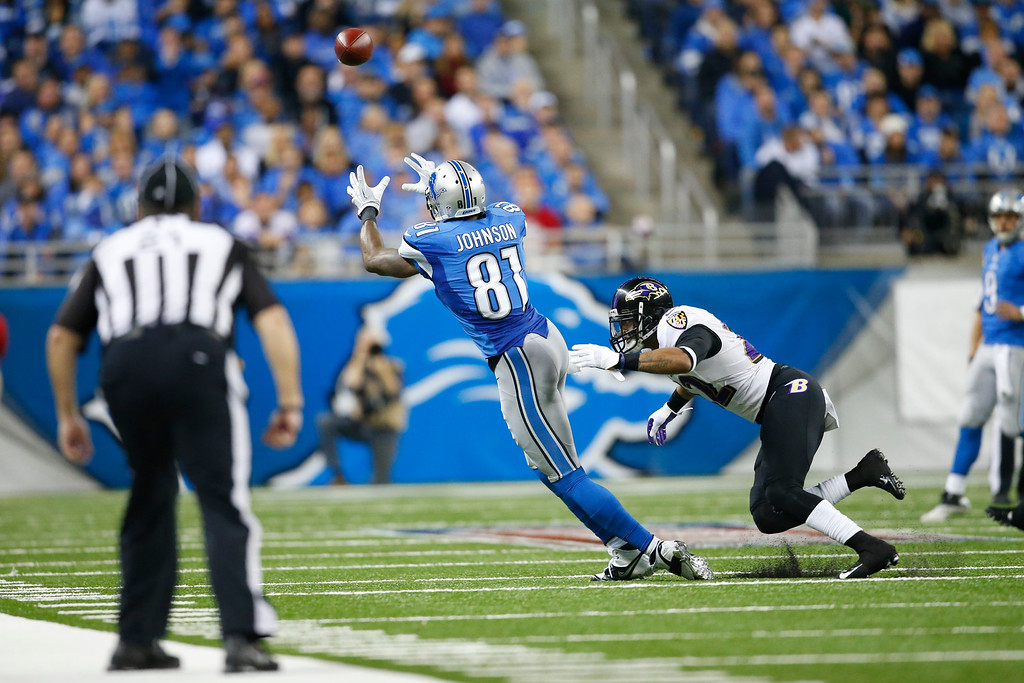 . Detroit Lions wide receiver Calvin Johnson (81) goes for a pass defended by Baltimore Ravens cornerback Jimmy Smith (22) during an NFL football game at Ford Field in Detroit, Monday, Dec. 16, 2013. (AP Photo/Rick Osentoski)