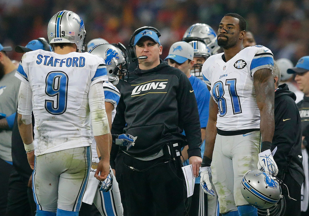 . Detroit Lions quarterback Matthew Stafford (9), left, walks towards wide receiver Calvin Johnson (81) and Detroit Lions offensive co-ordinator Jim Bob Cooter on the touchline during the NFL football game between Detroit Lions and Kansas City Chiefs Wembley Stadium in London,  Sunday, Nov. 1, 2015. (AP Photo/Matt Dunham)