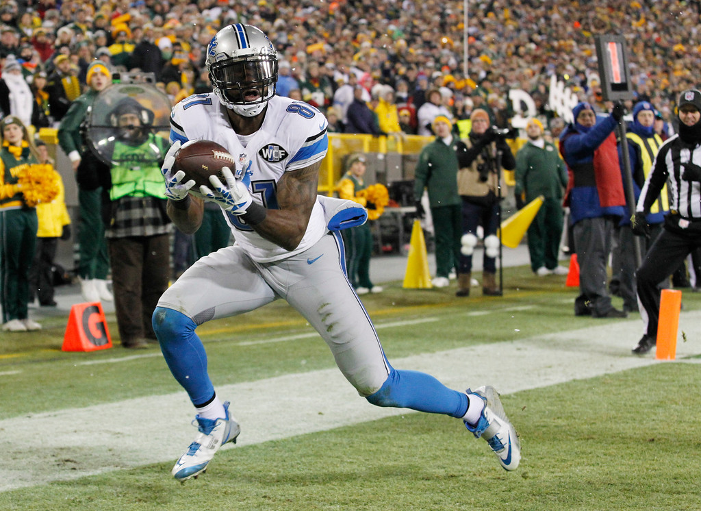 . FILE - In this Dec. 28, 2014, file photo, Detroit Lions\' Calvin Johnson catches a touchdown pass during an NFL football game against the Green Bay Packers in Green Bay, Wis. (AP Photo/Matt Ludtke, File)