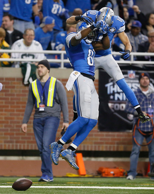 . Detroit Lions wide receiver Calvin Johnson (81) and wide receiver Corey Fuller (10) celebrate in the end zone after Johnson\'s touchdown during the first half of an NFL football game against the Green Bay Packers, Thursday, Dec. 3, 2015, in Detroit. (AP Photo/Duane Burleson)
