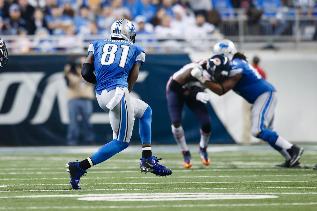 . Detroit Lions wide receiver Calvin Johnson (81) makes a reception against the Chicago Bears during an NFL football game at Ford Field in Detroit, Thursday, Nov. 27, 2014. (AP Photo/Rick Osentoski)