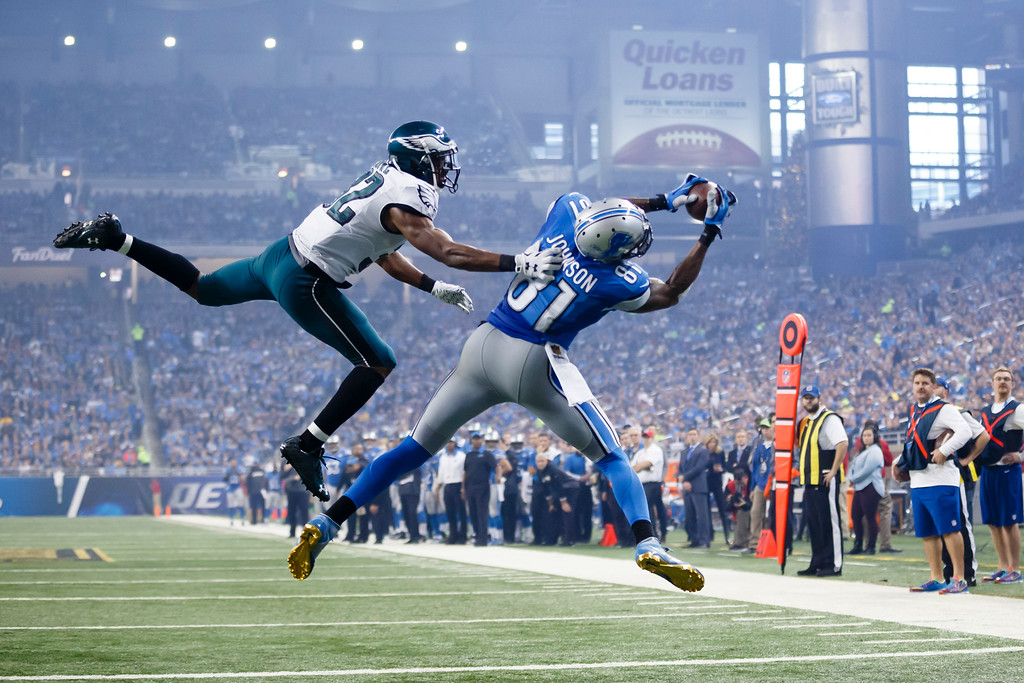 . Detroit Lions wide receiver Calvin Johnson (81), defended by Philadelphia Eagles cornerback Eric Rowe (32) catches a pass for a touchdown during the second half of an NFL football game, Thursday, Nov. 26, 2015, in Detroit. (AP Photo/Rick Osentoski)