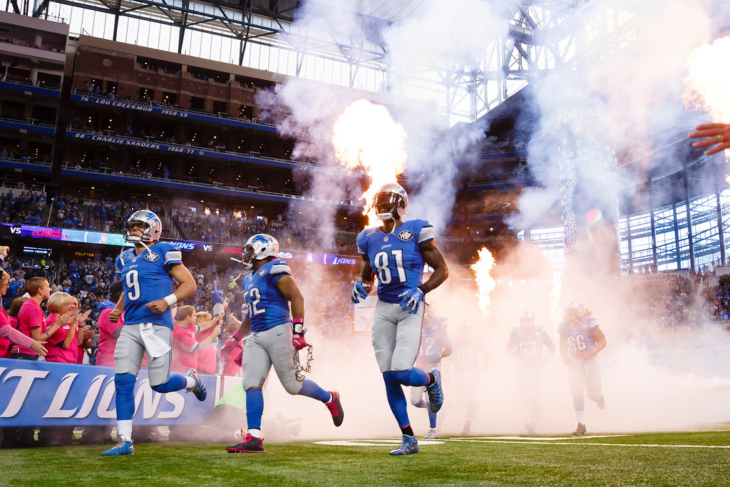. Detroit Lions quarterback Matthew Stafford (9), defensive end Darryl Tapp (52) and wide receiver Calvin Johnson (81) during player introductions prior to an NFL football game against the Arizona Cardinals at Ford Field in Detroit, Sunday, Oct. 11, 2015. (AP Photo/Rick Osentoski)
