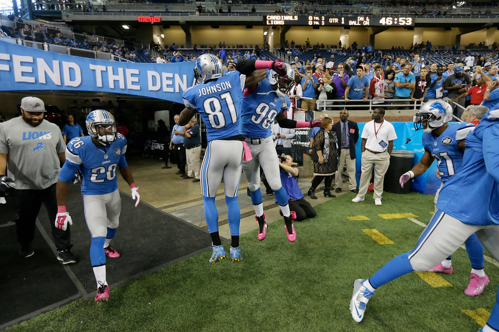 . Detroit Lions wide receiver Calvin Johnson (81) greets defensive end Devin Taylor (98) during pre-game warmups of an NFL football game against the Arizona Cardinals, Sunday, Oct. 11, 2015, in Detroit. (AP Photo/Carlos Osorio)