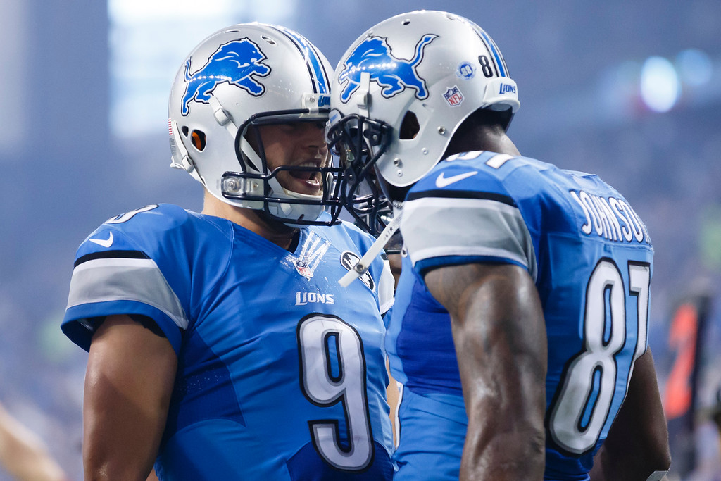 . Detroit Lions quarterback Matthew Stafford (9) and wide receiver Calvin Johnson (81) celebrate their touchdown against the Philadelphia Eagles during an NFL football game at Ford Field in Detroit, Thursday, Nov. 26, 2015. (AP Photo/Rick Osentoski)