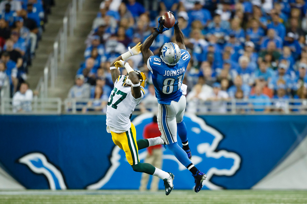. Detroit Lions wide receiver Calvin Johnson (81), defended by Green Bay Packers cornerback Sam Shields (37) makes a catch during the first half of an NFL football game in Detroit, Sunday, Sept. 21, 2014. (AP Photo/Rick Osentoski)
