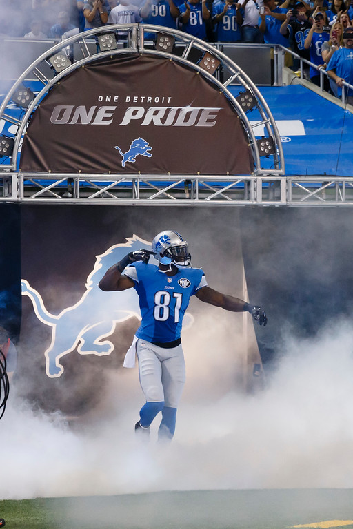 . Detroit Lions wide receiver Calvin Johnson (81) during player introductions before an NFL football game against the New York Giants at Ford Field in Detroit, Monday, Sept. 8, 2014. (AP Photo/Rick Osentoski)