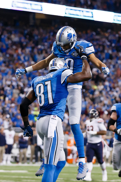 . Detroit Lions wide receiver Calvin Johnson receives congratulations from wide receiver Corey Fuller (10) after his 25-yard reception for a touchdown during the first half of an NFL football game against the Chicago Bears in Detroit, Thursday, Nov. 27, 2014. (AP Photo/Rick Osentoski)
