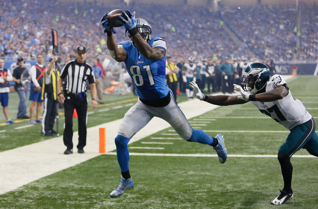 . Detroit Lions wide receiver Calvin Johnson (81) catches a pass for a touchdown defended by Philadelphia Eagles free safety Malcolm Jenkins (27) during the second half of an NFL football game, Thursday, Nov. 26, 2015, in Detroit. (AP Photo/Duane Burleson)