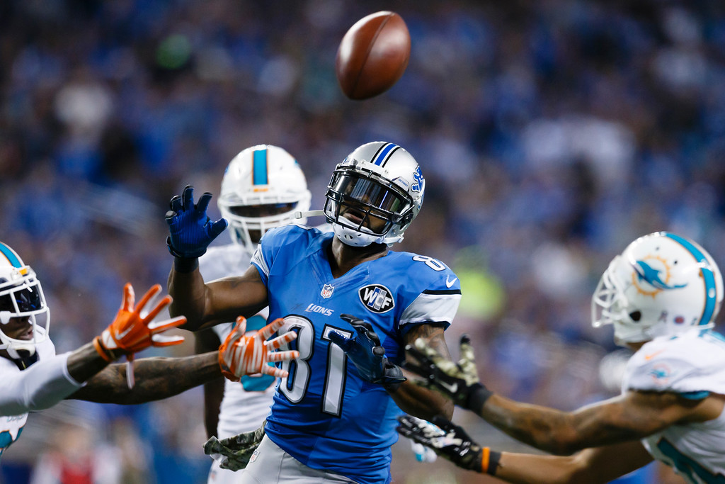 . Detroit Lions wide receiver Calvin Johnson (81) tries to catch a overthrown pass against the Miami Dolphins during an NFL football game at Ford Field in Detroit, Sunday, Nov. 9, 2014. (AP Photo/Rick Osentoski)