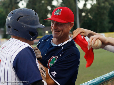 Coach Fred Ludwig greets Cameron Olson with a smile and congratulative handshake as Olson come in from a homer that put the Heat one run over the Lodi Crushers August 8, 2016 at Nettleton Stadium in Chico, Calif. (Emily Bertolino -- Enterprise-Record)