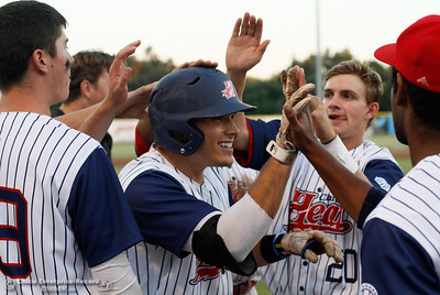 Teammates celebrate with Cameron Olson, center, after his homer in the bottom of the fourth for a 1-0 lead over the Lodi Crushers in the regular-season home finale August 8, 2016 at Nettleton Stadium in Chico, Calif. (Emily Bertolino -- Enterprise-Record)