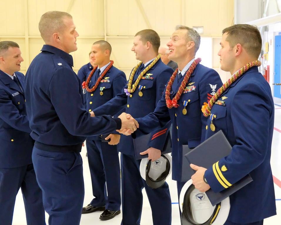 . Shaun Walker � The Times-Standard  U.S. Coast Guard Sector Humboldt Bay Operations Officer Brendan Hilleary[CQ], foreground left, shakes hands with, left to right facing him,  Lieutenant Edwin Forteza, Petty Officer Jeff Bothman, Petty Officer Nicholas Gardner, and Lieutenant Jacob Dorsey after they received awards at a ceremony at the air station in McKinleyville on Thursday. Rear Adm. Todd Sokalzuk, the Coast Guard 11th District commander, presented medals to them for the aircrew\'s rescue of the 16-year-old boy from a cliff face 300 feet above the ocean near Crescent City on the evening of Oct. 14, 2017. As there was another 500 feet of cliff above him, the helicopter was brought to a hover approximately 240 feet above the stranded hiker. Gardner deployed from the helicopter and reached the hiker with only five feet of line remaining on the helicopter\'s hoist cable. He and the hiker were hoisted into the helicopter and the rescued teen was taken to Del Norte County Airport and transferred to a waiting ambulance crew without injury. While the Coast Guard regularly conducts cliff rescue training, the physical characteristics and height of the cliff face paired with the on-scene conditions of 20-knot winds and low visibility contributed to the complexity of the rescue.