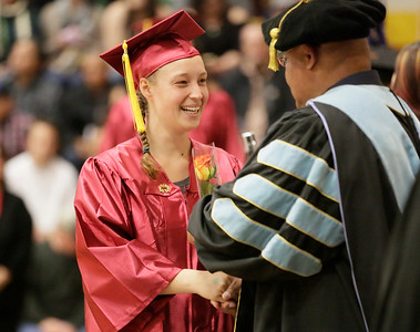 Shaun Walker — The Times-Standard  Devin Price shakes hands with College of the Redwoods President Keith Snow-Flamer after graduating at the Eureka campus on Saturday. A total of 598 degrees and certificates were awarded to 492 students during the ceremony.