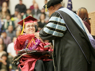 Shaun Walker — The Times-Standard  Damian Kelsey shakes hands with College of the Redwoods President Keith Snow-Flamer after graduating at the Eureka campus on Saturday. A total of 598 degrees and certificates were awarded to 492 students during the ceremony.