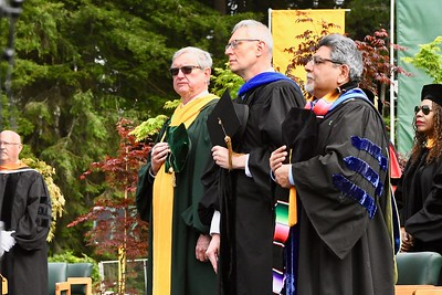 Past HSU President Rollin Richmond, in yellow gown scarf, stands with other HSU administration.  José Quezada—For Times-Standard