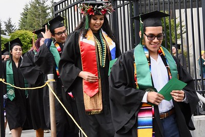 College of Arts, Humanities and Social Sciences students descend down steps to the Redwood Bowl to take their seats before graduating. José Quezada—For Times-Standard