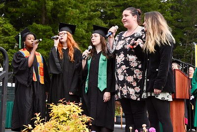 Sabrina Fisher, Helen Kimber, Allie MertenElisha Moore and Amber Rausch sing the National Anthem before the College of Arts, Humanities and Social Sciences students. José Quezada—For Times-Standard