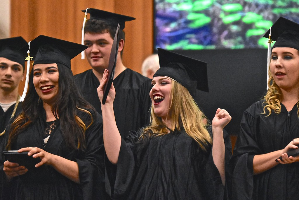 . Faith Cannafax-Anderson celebrates with fellow graduates at end of ceremony.  (José Quezada�For the Times-Standard)