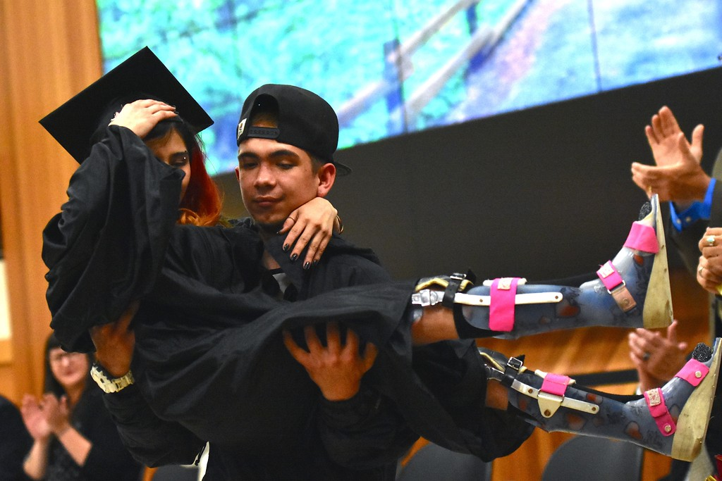 . Twin brother Thomas Wheeler picks his sister Taylor Marie Wheeler up after she walked by herself to receive her diploma.  (José Quezada�For the Times-Standard)