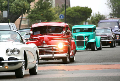 Shaun Walker — The Times-Standard  Colorful cars rumble down Second Street during the Cruz'n Eureka cruise through Old Town on Friday evening. The Boys and Girls Club of the Redwoods fundraising event continues today with the car show on Second from 10 a.m. to 4 p.m.