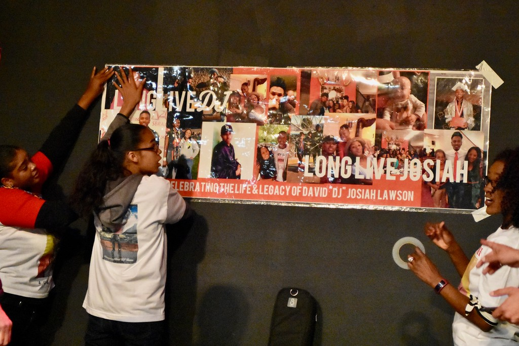 . Members of the David Josiah Lawson\'s family put up a celebration poster. José Quezada�For the Times-Standard