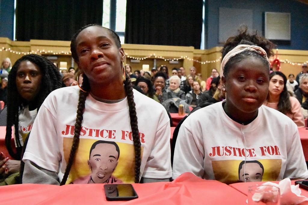 . David Josiah Lawson\'s cousins Deshawna Ferrel and Terri Adams listen to Charmaine Lawson (not pictured) describe her son. José Quezada�For the Times-Standard
