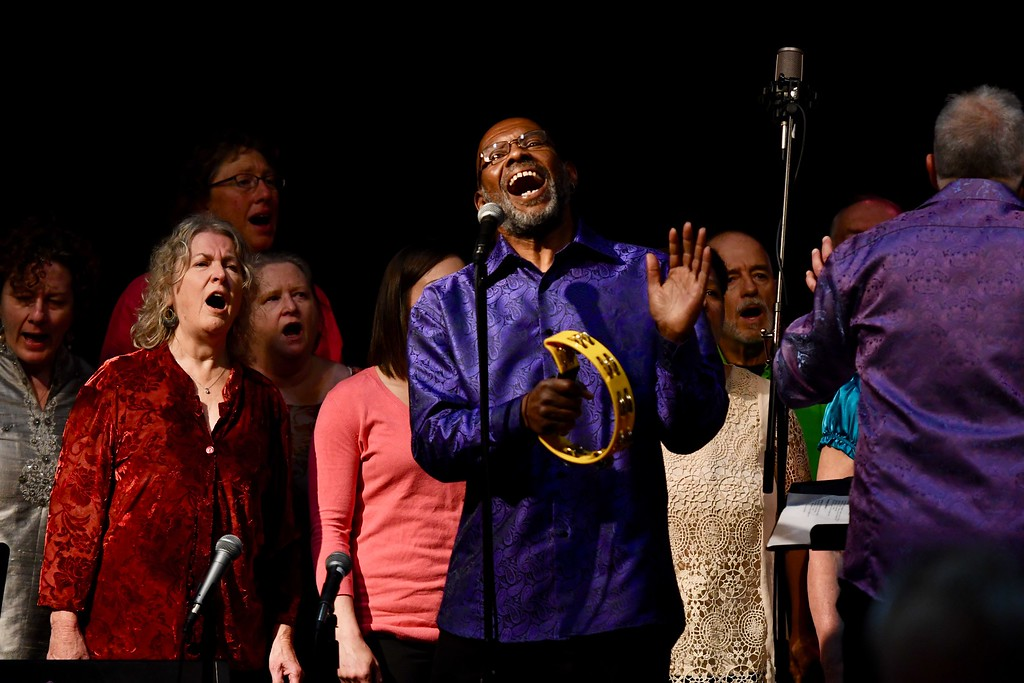 . Jeff Thomas leads a spiritual with the Arcata Interfaith Gospel Choir on Sunday afternoon during a celebration of David Josiah Lawson\'s life. José Quezada�For the Times-Standard