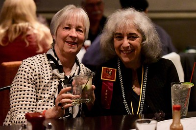 Long time Redwood Coast Music Festival organizer Lynn McKenna, right, has an end of festival drink with her friend Georgeanna Chess at the Sunday After-Party at the Red Lion Inn. José Quezada—For Times-Standard