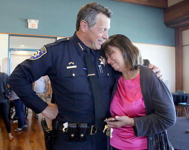 Shaun Walker — The Times-Standard  Outgoing Eureka Police Chief Andrew Mills, left, hugs and chats with philanthropist for local homeless Betty Chinn at a going away reception for the chief on Wednesday.