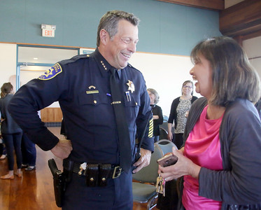 Shaun Walker — The Times-Standard  Outgoing Eureka Police Chief Andrew Mills, left, laughs and chats with philanthropist for local homeless Betty Chinn at a going away reception for the chief on Wednesday.