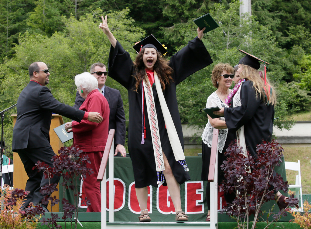 . Shaun Walker � The Times-Standard  Kate Conely celebrates after getting her diploma at Eureka High School\'s graduation ceremony on Friday. The school graduated about 250 seniors in Albee Stadium.