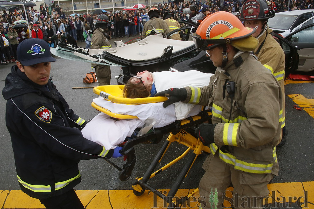 . Shaun Walker � The Times-Standard  Emergency personnel take pretend DUI accident victim Nigella Bauerlighter to an ambulance during a simulated student drunk driving accident scene in front of Arcata High School on Thursday morning as a student film crew documents it for an assembly. Every 15 Minutes is a two-day program which demonstrates to high school students the impact drinking and driving has on friends, families, and their community. The event included emergency responses from police, fire, ambulance, coroner, public works, and tow truck companies. The program will conclude with a mock funeral assembly.